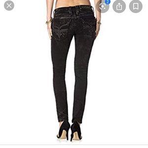 Black distressed skinny rock revival jeans